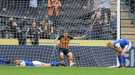 Flynn Downes is distraught after his mistake led to the first Hull goal after four minutes. Photo: P