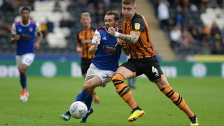 Gwion Edwards is shouldered off the ball at Hull Picture Pagepix