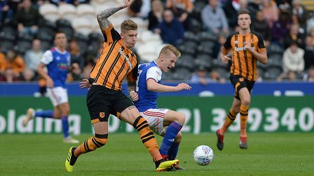 Flynn Downes is barged off the ball at Hull by Jordy De Wijs Picture Pagepix