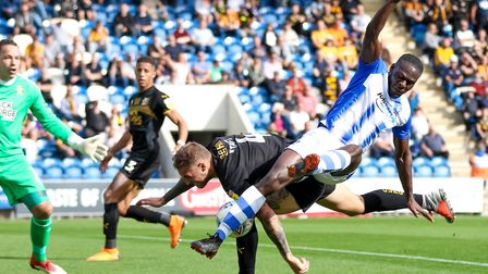 U's man of the match Frank Nouble collides with George Taft during yesterday's 3-0 home win over Cam