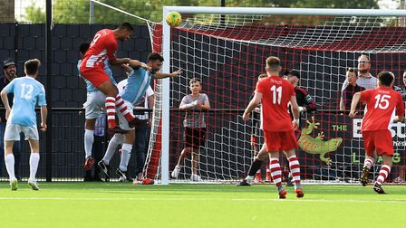GOAL! Lewis Manor's towers over the Seasiders defence to make it 4-0 for Bowers & Pitsea. Photo: ST