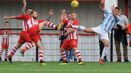 Bowers & Pitsea's Callum Leahy (red) battles with Seasiders Darcy D'eath (blue) Photo: STAN BASTON
