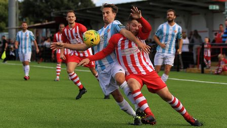 Seasiders' Jordy Matthews (blue) in close tussle with Bowers & Pitsea's Ben Sartain Photo: STAN BAST