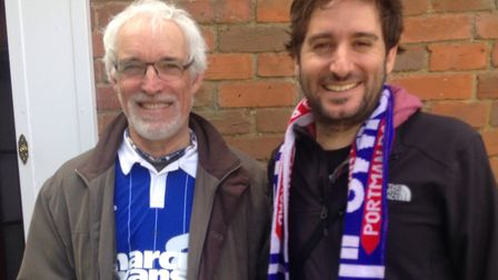 Vicky's dad Tony Gould with Sebastian on their way to an Ipswich Town game Picture: SUPPLIED BY FAMI