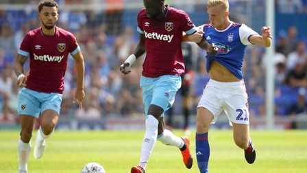 West Ham United's Cheikhou Kouyate and Ipswich Town's Flynn Downes battle for the ball pre-season.
