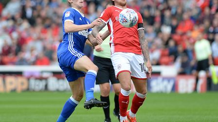 Flynn Downes challenges Barnsley's George Moncur Picture Pagepix