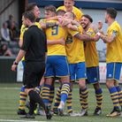 AFC Sudbury players celebrate Paul Hayes' winning goal in their FA Cup clash with Royston. Picture: