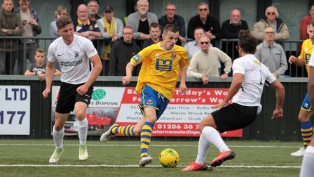 AFC Sudbury's Jordan Blackwell runs at the Royston defence. Picture: CLIVE PEARSON