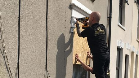 Windows boarded up at an address in Ipswich Picture: GEMMA MITCHELL