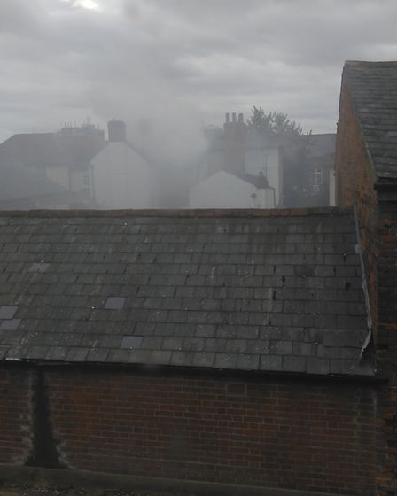 Smoke billowed from the hole made in the roof of the pub as firefighters extinguished the blaze at t