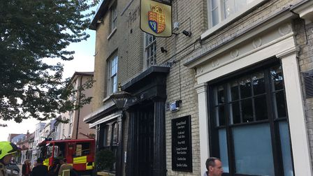 Firefighters clear the scene after the fire on the top floor of the pub. Picture: JAKE FOXFORD