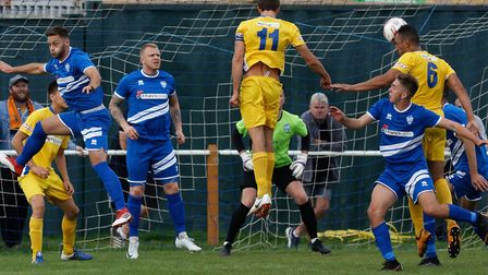 Brantham are on the defensive as Kern Miller (No. 6) heads narrowly wide for Spalding United. Pictur