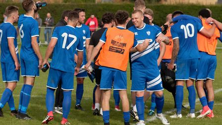 Hugs and handshakes all round as Brantham Athletic players celebrate their FA Cup success on Saturda