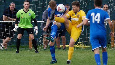 Brantham's Jack Marshall almost gets a boot in the face as he makes a brave challenge. Picture: PAUL