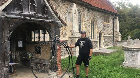 Jason Bullard from the Southern Vintage Cycle Club outside All Saints Church, Little Wenham with his
