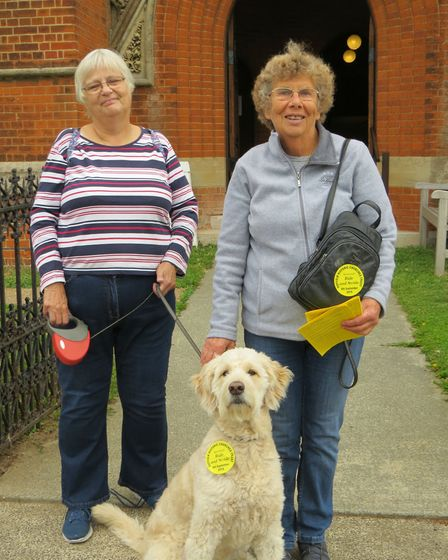 Bella the dog walked around Felixstowe churches to collect her sponsorship money of £84, helped by M