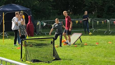 Children got to test their football skills at the fete Picture: BALLINGDON FETE COMMITTEE