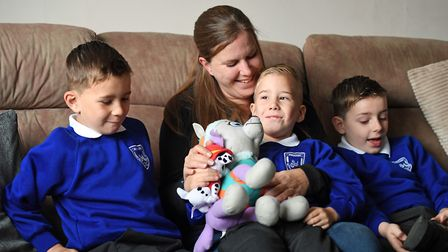Four-year-old Alexander Pickering (centre), known as Xander, with his mum Kiera and older brothers T