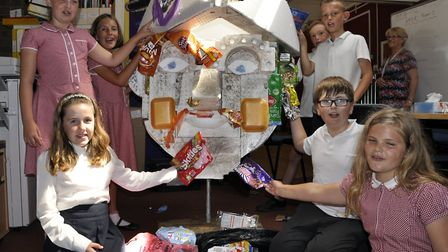 Youngsters from Kingsfleet Primary at work on Captain Fanplastic Picture: JAYNE LINDILL