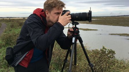 East Anglian photographer Owen Clarke scouting locations for future pictures at Felixstowe Ferry Pho