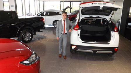 Sales controller Jacob Warner in the EMG Mitsubishi showroom at Ipswich. Picture: Andy Russell