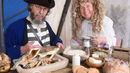 Liz Scott sorting out the ship's provisions, with Russ Scott, a naval officer and navigator, at the
