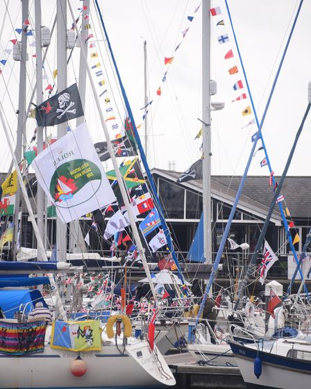 Colourful bunting and flags fly on the boats for the Ipswich Maritime Festival at the Waterfront. Pi