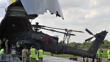 The gigantic craft unloads one of the Apaches Picture: GARETH PALMER