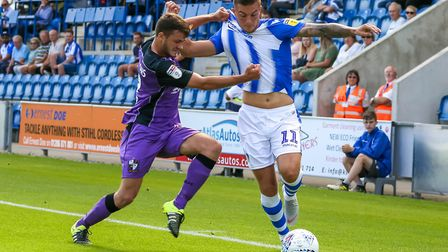 Brennan Dickenson shrugs off the attentions of Port Vale's James Gibbons during the first home match