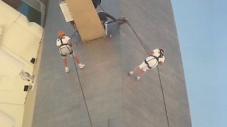 Trevor Root and Mandy Foster abseiling down the Spinnaker Tower, in Portsmouth. Picture: TREVOR ROOT