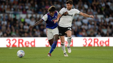 Trevoh Chalobah chases for the ball with David Nugent at Derby Picture Pagepix