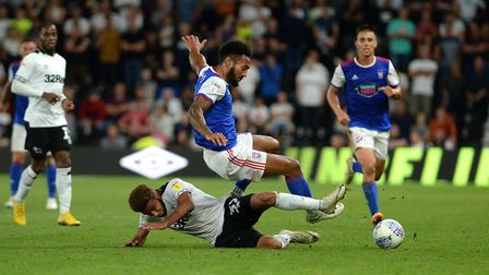 Jordan Roberts is well tackled by Jayden Bogle at Derby Picture Pagepix