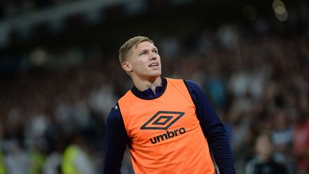 Former Ipswich striker Martyn Waghorn watches the replay of the second Derby goal on the big screen