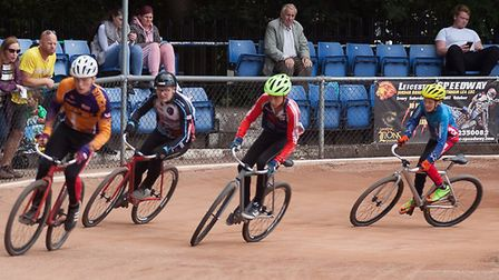 Stockport's Devon Campbell leads Ipswich's Harvey Young, with Coventry's Lee Greogory and Poole's Ma