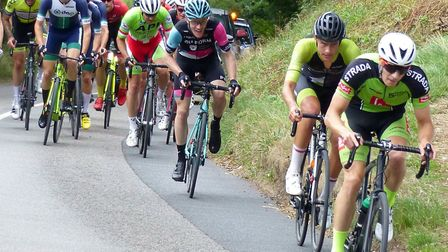 Tom Heal (Strada) attacks Skeets Hill with Jack Hardwicke (Pedal Power Ipswich) close on his wheel.