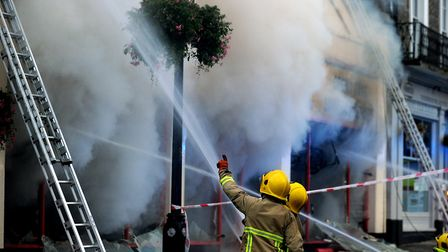 Firefighters tackle the serious fire at the Cycle King shop on Angel Hill in Bury St Edmunds. Pic
