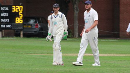 Sudbury's Adam Mansfield, left, talks to all-rounder Michael Comber during the match against Lincoln