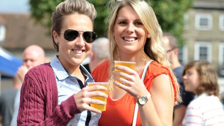 Sammy Jones and Alice Mann enjoy a drink in the sun Picture: SARAH LUCY BROWN