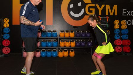 Wez Pooley putting young tennis player Anya Taylor through a strength and conditioning session. Pict