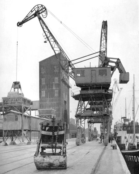 Cliff Quay, Ipswich, around 1960, with a crane unloading to the Fison's site Picture: JOAN SMITH