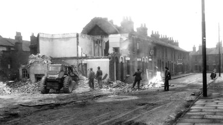 Work to demolish the houses in White Elm Street, Ipswich, in January 1959 Picture: DAVID KINDREDS AR