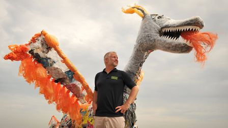 Wildlife Gadget Man Jason Alexander at Felixstowe with the dragon made out of non recyclable rubbish
