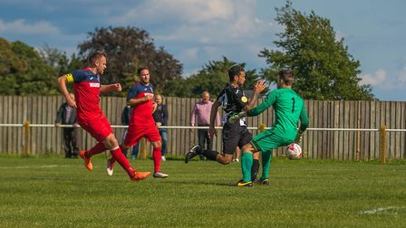Former Ipswich Town star Carlos Edwards rounds the 'keeper to score for the Woodpeckers against Hadl