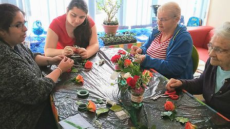 Local Residents enjoying floristry at the EqualiTea supported by Realise Futures at the Waterfront
