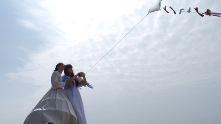 Jo and Beth fly a kite in the musical of Little Women staged by Appeal Theatre Company in 2013. Pict