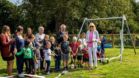 The ribbon cutting to mark the opening of the refurbished play equipment at Stratford St Andrew's Ri