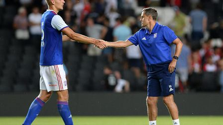 Paul Hurst shakes the hand of Luke Woolfenden, who has joined Swindon on loan. Picture Pagepix