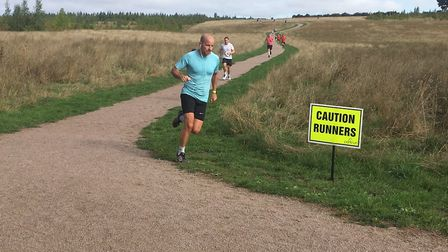 Runners negotiate the undulating gravel paths around Heartwood Forest during last weekend's parkrun.