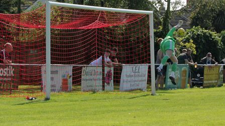Jack Spurling pulls off one in a string of fine saves to deny Aveley. Photo: PHIL GRIFFITHS