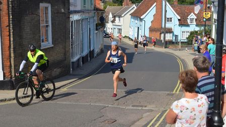 Jack Millar, already with just the lead cyclist for company, during the Framlingham 10K road race. P